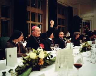 Austria, Mariazell. 2010. Convivial celebration meal with the local community representatives closing a CCEE Environment Commission meeting. Mgr Le?onard, archbishop of Mechelen-Bruxelles, singing.