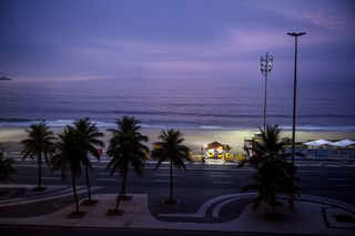 Copacabana street and beach scene at dusk. Rio de Janeiro. Brazil. 2011. © David Alan Harvey Magnum Photos